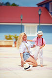 Funny moment of hat fallen of the mother's head, caribbean backg. Funny moment of hat has fallen of the mother's head, caribbean background stock photos