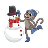 Funny monkey sculpts snowman Royalty Free Stock Images