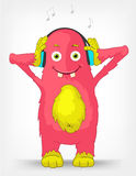 Funny Monster. Listening to Music. Royalty Free Stock Images