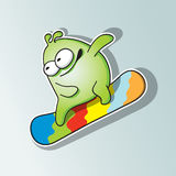 Funny monster snowboarder rides. Royalty Free Stock Photography