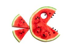 Funny monster with tail of ripe watermelon. Merry watermelon. Silhouette of a fantastic creature with a tail and teeth made up of slices of red watermelon on a stock images