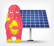 Funny Monster. Thinking about Solar Energy. Stock Image