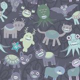 Funny monsters seamless pattern on dark background. Vector Royalty Free Stock Image