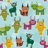 Funny monsters Set. seamless pattern on blue background. Vector Stock Photo