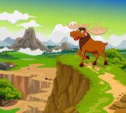 Funny moose cartoon with mountain landscape background Royalty Free Stock Photography