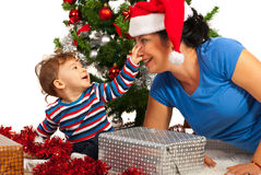 Funny mother with her baby at Christmas Royalty Free Stock Images