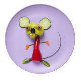 Funny mouse made of vegetables. On pink plate Royalty Free Stock Photo