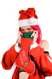 Funny Mrs. Santa with Christmas stocking stock photos