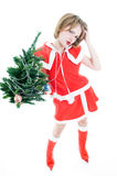Funny mrs. Santa with Christmas tree Stock Images