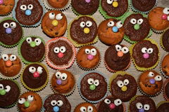 Funny muffins with face Stock Photos