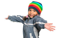 Funny multiracial small girl offering a hug Royalty Free Stock Photography