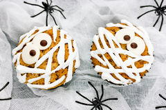 Funny mummy cupcakes on white background with spiders Stock Photo