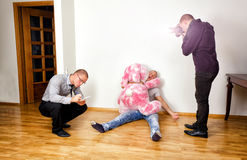 Funny murder scene. With two forensic analysts investigating a crime royalty free stock photo