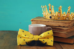 Funny mustache, cup of coffee, bow and king crown. Father& x27;s day Royalty Free Stock Image