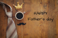 Funny mustache cup of coffee, crown and tie. Father& x27;s day concept Stock Photo