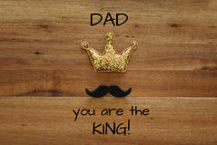 funny mustache and glitter crown. Father& x27;s day concept stock image