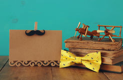 Funny mustache, greeting card, bow and books. Father& x27;s day concept Stock Photography