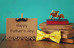 Funny mustache, greeting card, bow and books. Father& x27;s day concept Royalty Free Stock Images