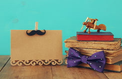Funny mustache, greeting card, bow and books. Father& x27;s day concept Stock Photo