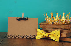 Funny mustache, greeting card, bow and king crown. Father& x27;s day Royalty Free Stock Photo