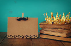 funny mustache, greeting card and king crown. Father& x27;s day conce Royalty Free Stock Photo