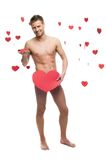 Funny naked man holding big red paper heart Stock Photo