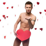 Funny naked man holding big red paper heart Royalty Free Stock Image