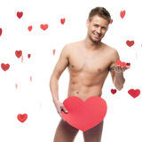 Funny naked man holding big red paper heart Royalty Free Stock Photo