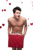 Funny naked man holding christmas gift Stock Photography
