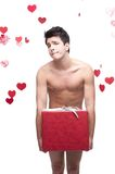 Funny naked man holding christmas gift Stock Photo