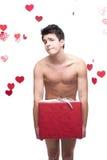 Funny naked man holding christmas gift Stock Photo