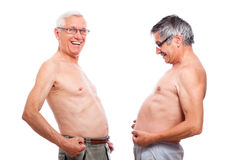 Funny naked seniors comparing belly. Two happy naked senior men comparing belly, isolated on white background stock images