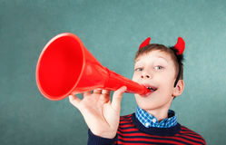 Funny naughty schoolboy playing red pipe smiling Royalty Free Stock Photos