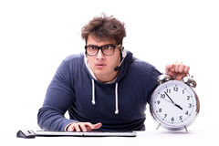 The funny nerd call center operator with giant clock Stock Photos