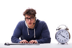 The funny nerd call center operator with giant clock Stock Images