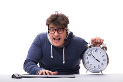 The funny nerd call center operator with giant clock Stock Photo