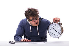 Funny nerd call center operator with giant clock Stock Photography