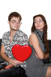 Funny Nerd Guy Gives A Valentine Glamorous Girl Royalty Free Stock Photo
