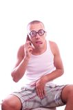 Funny nerd guy has a phone sex Royalty Free Stock Images
