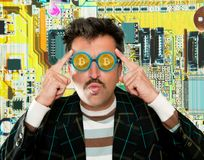Nerd hacker with Bitcoin BTC glasses in circuit Royalty Free Stock Photos