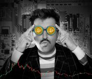 Nerd hacker with Bitcoin BTC glasses in circuit Stock Images