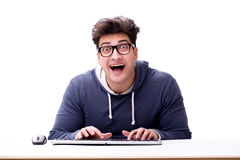Funny nerd man working on computer isolated on white Royalty Free Stock Photos