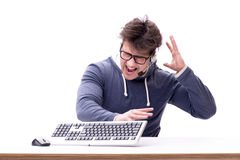 The funny nerd man working on computer isolated on white Royalty Free Stock Images
