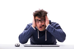 The funny nerd man working on computer isolated on white Royalty Free Stock Image