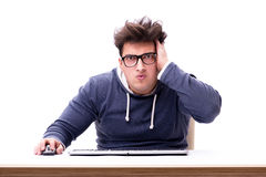 Funny nerd man working on computer isolated on white. Funny nerd man working on computer Royalty Free Stock Images
