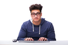 Funny nerd man working on computer isolated on white. Funny nerd man working on computer isolated Royalty Free Stock Photography