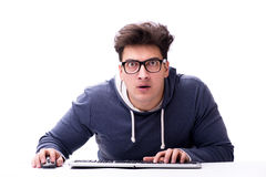 Funny nerd man working on computer isolated on white. Funny nerd man working on computer isolated Royalty Free Stock Photos