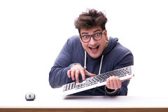 Funny nerd man working on computer isolated on white. Funny nerd man working on computer isolated Royalty Free Stock Image