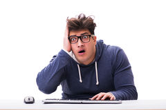 Funny nerd man working on computer isolated on white Royalty Free Stock Images