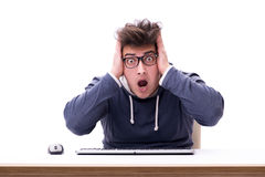 The funny nerd man working on computer isolated on white Royalty Free Stock Photo